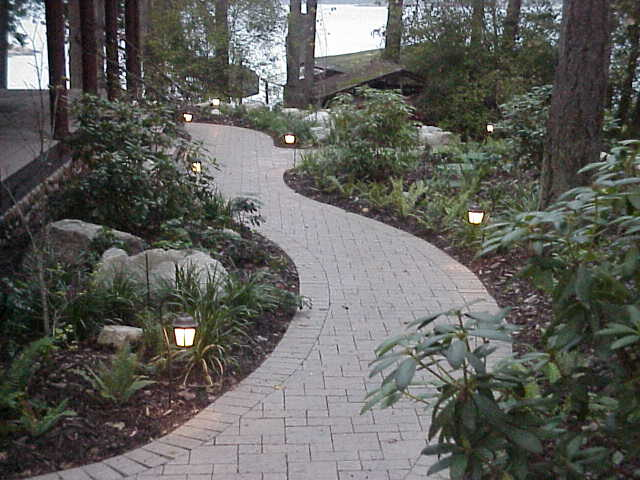 Paver path through native plantings.